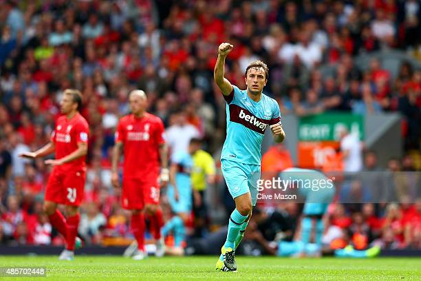 Mark Noble of West Ham United celebrates scoring his team's second goal from the penalty spot during the Barclays Premier League match between...