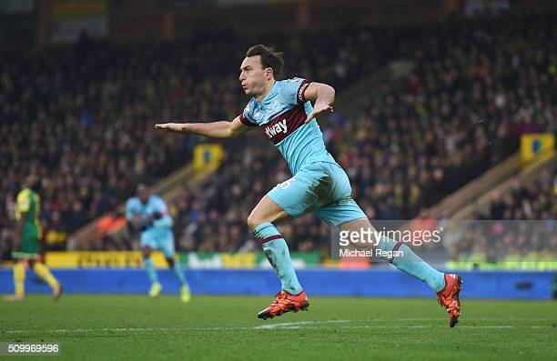 Mark Noble of West Ham United celebrates scoring his team's second goal during the Barclays Premier League match between Norwich City and West Ham...