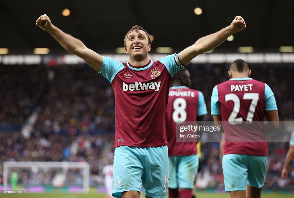 Mark Noble of West Ham United celebrates scoring his team's third goal during the Barclays Premier League match between West Bromwich Albion and West Ham United at The Hawthorns on April 30, 2016 in West Bromwich, England.
