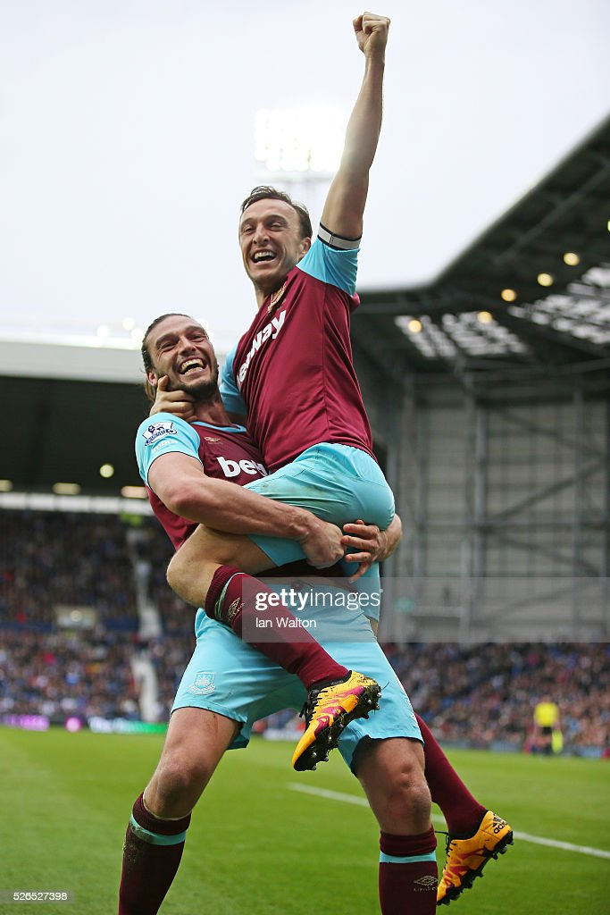 Mark Noble (R) of West Ham United celebrates scoring his team's third goal with his team mate Andy Carroll (L) during the Barclays Premier League match between West Bromwich Albion and West Ham United at The Hawthorns on April 30, 2016 in West Bromwich, England.