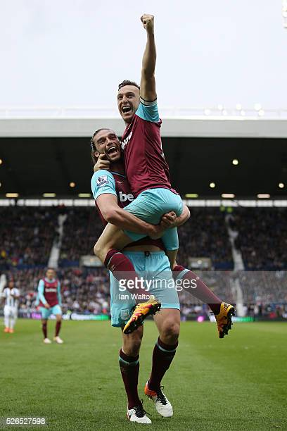 Mark Noble of West Ham United celebrates scoring his team's third goal with his team mate Andy Carroll during the Barclays Premier League match...