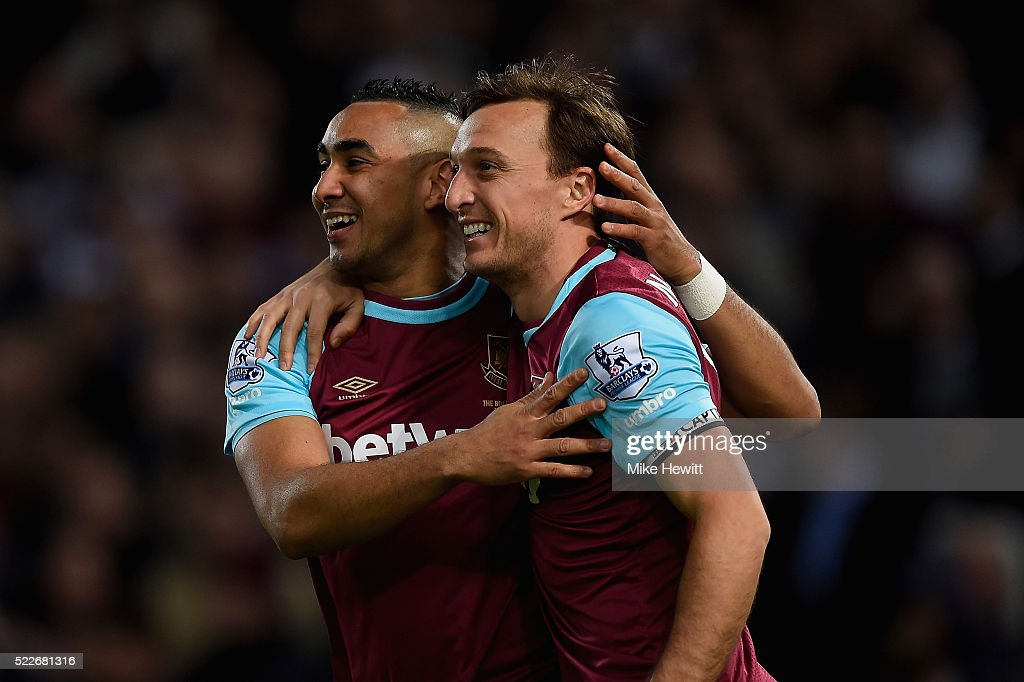 Mark Noble of West Ham United celebrates with Dimitri Payet of West Ham United scoring his second goal during the Barclays Premier League match...