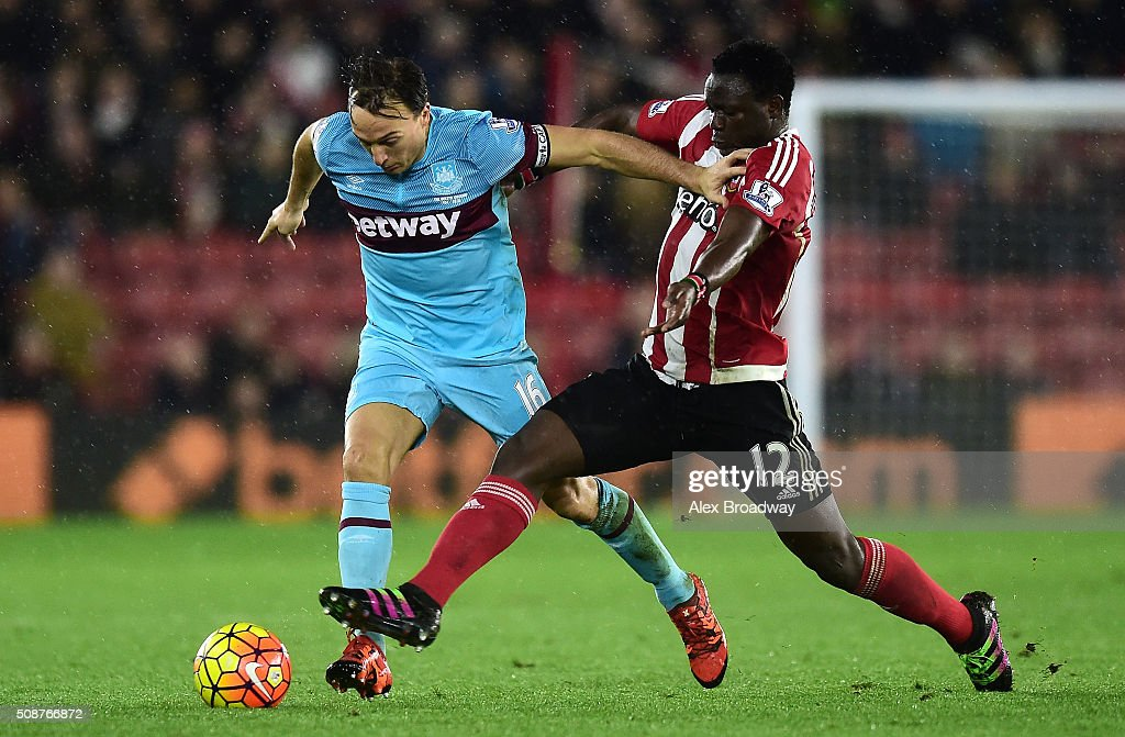 <a gi-track='captionPersonalityLinkClicked' href=/galleries/search?phrase=Mark+Noble&family=editorial&specificpeople=844055 ng-click='$event.stopPropagation()'>Mark Noble</a> of West Ham United holds off <a gi-track='captionPersonalityLinkClicked' href=/galleries/search?phrase=Victor+Wanyama&family=editorial&specificpeople=7126412 ng-click='$event.stopPropagation()'>Victor Wanyama</a> of Southampton during the Barclays Premier League match between Southampton and West Ham United at St Mary's Stadium on February 6, 2016 in Southampton, England.