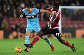 Mark Noble of West Ham United holds off Victor Wanyama of Southampton during the Barclays Premier League match between Southampton and West Ham...