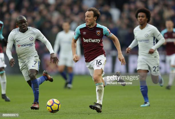 Mark Noble of West Ham United is chased by N'Golo Kante of Chelsea during the Premier League match between West Ham United and Chelsea at London...