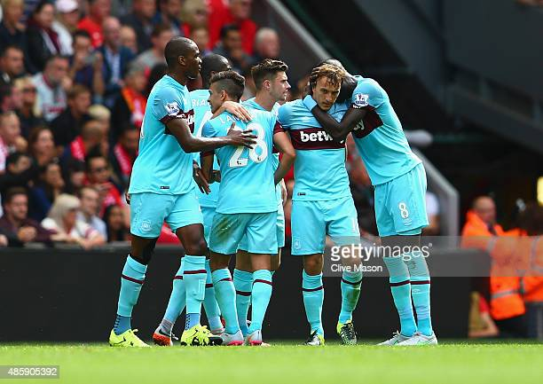 Mark Noble of West Ham United is congratulated on his goal during the Barclays Premier League match between Liverpool and West Ham United at Anfield...