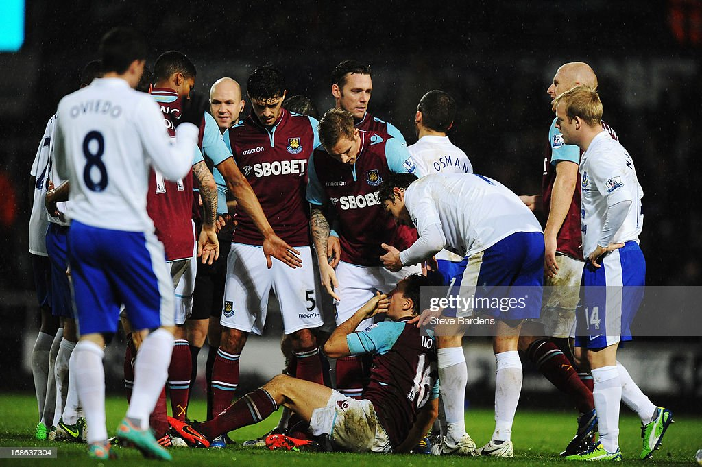 <a gi-track='captionPersonalityLinkClicked' href=/galleries/search?phrase=Mark+Noble&family=editorial&specificpeople=844055 ng-click='$event.stopPropagation()'>Mark Noble</a> of West Ham United is injured by a tackle by Darron Gibson of Everton who was subsequently sent off during the Barclays Premier League match between West Ham United and Everton at the Boleyn Ground on December 22, 2012 in London, England.