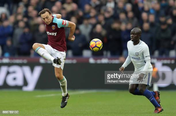 Mark Noble of West Ham United it put under pressure by N'Golo Kante of Chelsea during the Premier League match between West Ham United and Chelsea at...
