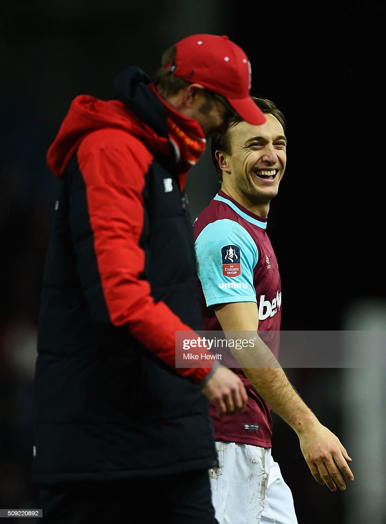 <a gi-track='captionPersonalityLinkClicked' href=/galleries/search?phrase=Mark+Noble&family=editorial&specificpeople=844055 ng-click='$event.stopPropagation()'>Mark Noble</a> of West Ham United jokes with Jurgen Klopp manager of Liverpool after the Emirates FA Cup Fourth Round Replay match between West Ham United and Liverpool at Boleyn Ground on February 9, 2016 in London, England.