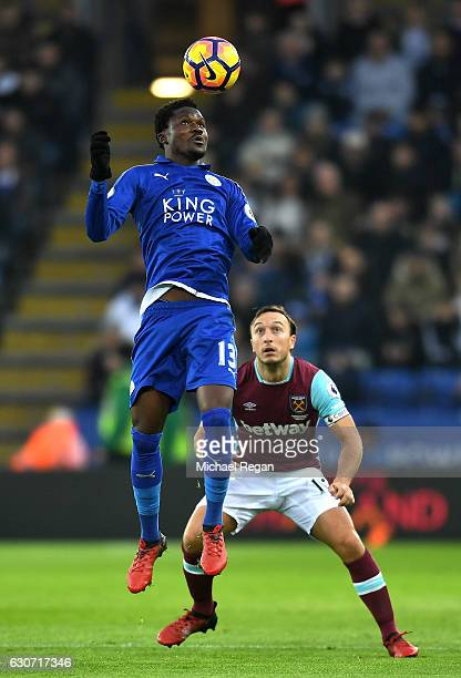 Mark Noble of West Ham United looks on as Daniel Amartey of Leicester City wins a header during the Premier League match between Leicester City and...