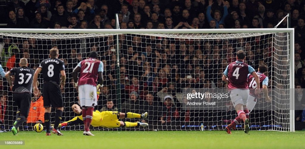 <a gi-track='captionPersonalityLinkClicked' href=/galleries/search?phrase=Mark+Noble&family=editorial&specificpeople=844055 ng-click='$event.stopPropagation()'>Mark Noble</a> of West Ham United scores a penalty during the Barclays Premier League match between West Ham United and Liverpool at Boleyn Ground on December 9, 2012 in London, England.