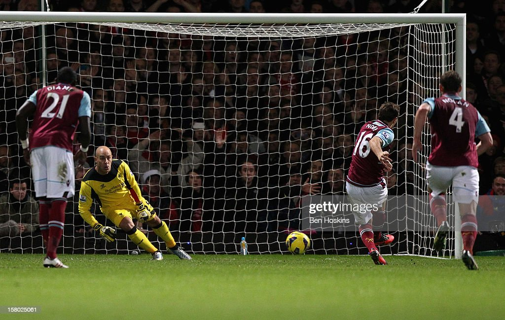 Mark Noble of West Ham United scores his penalty past Pepe Reina of Liverpool during the Barclays Premier League match between West Ham United and Liverpool at the Boleyn Ground on December 9, 2012 in London, England.