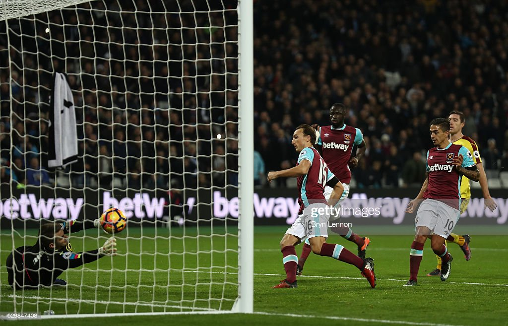 Mark Noble of West Ham United (C) scores his sides first goal during the Premier League match between West Ham United and Burnley at London Stadium on December 14, 2016 in Stratford, England.