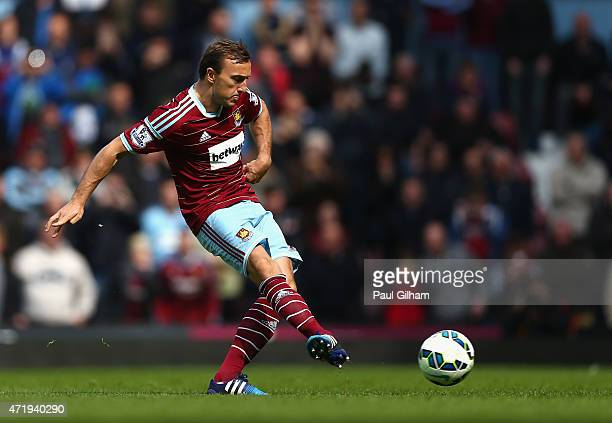 Mark Noble of West Ham United scores his team's first goal from the penalty spot during the Barclays Premier League match between West Ham United and...