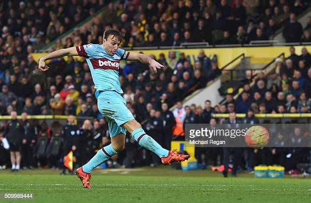 Mark Noble of West Ham United scores his team's second goal during the Barclays Premier League match between Norwich City and West Ham United at...