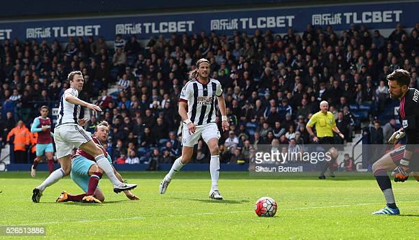 Mark Noble of West Ham United scores his team's second goal during the Barclays Premier League match between West Bromwich Albion and West Ham United...