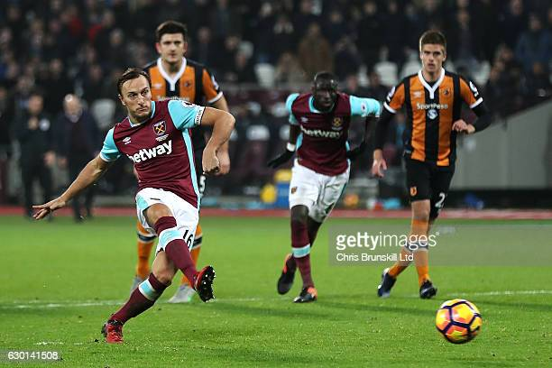 Mark Noble of West Ham United scores the first goal from a penalty kick to make the score 10 during the Premier League match between West Ham United...