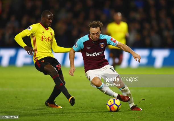 Mark Noble of West Ham United takes on Abdoulaye Doucoure of Watford during the Premier League match between Watford and West Ham United at Vicarage...