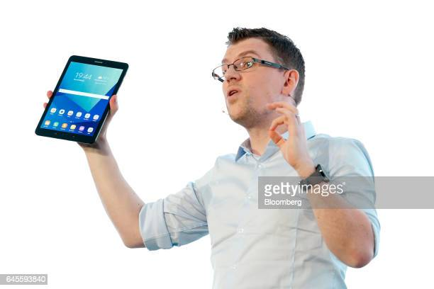 Mark Notton executive at Samsung Electronics Co holds the company's Galaxy Tab S3 tablet device during the Samsung Press Conference ahead of the...