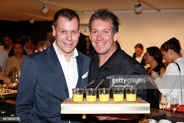 Mark O Eckert and Shane Mcmahon attend the Bulthaup Showroom Opening on July 03 2014 in Munich Germany