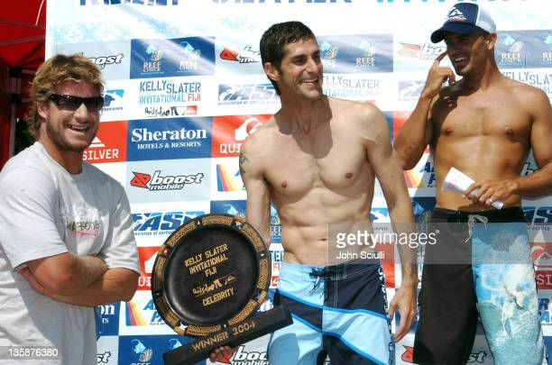 Mark Occhilupo and Perry Farrell accept 1st Place trophy from Kelly Slater