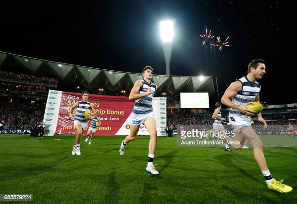 Mark O'Connor and Daniel Menzel of the Cats run out during the 2017 AFL round 09 match between the Geelong Cats and the Western Bulldogs at Simonds...