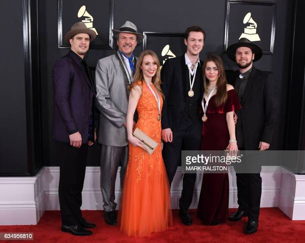 Mark O'Connor and the O'Connor band arrive for the 59th Grammy Awards pretelecast on February 12 in Los Angeles California / AFP / Mark RALSTON