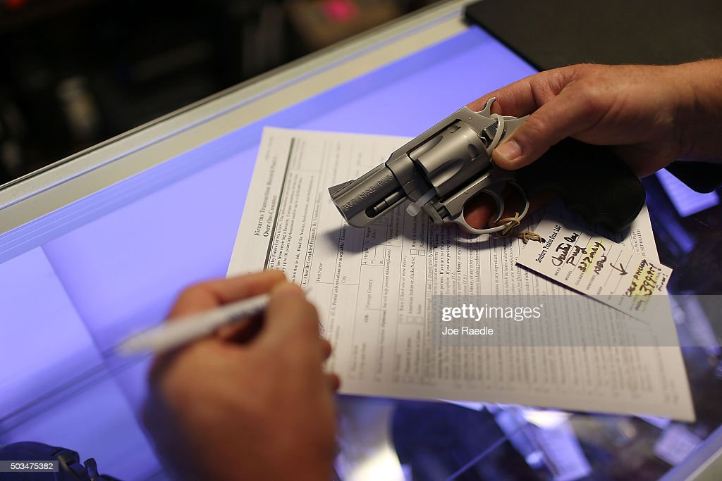 Mark O'Connor fills out his Federal background check paperwork as he purchases a handgun at the KW Gunworks store on the day that US President Barack...