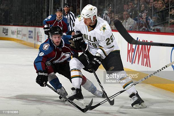 Mark Olver of the Colorado Avalanche tries to knock the puck away from Steve Ott of the Dallas Stars in the first period at the Pepsi Center on April...