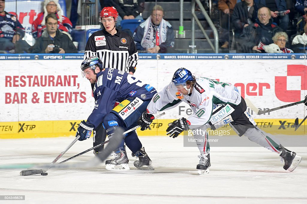 <a gi-track='captionPersonalityLinkClicked' href=/galleries/search?phrase=Mark+Olver+-+Ice+Hockey+Player&family=editorial&specificpeople=10840791 ng-click='$event.stopPropagation()'>Mark Olver</a> of the Eisbaeren Berlin and <a gi-track='captionPersonalityLinkClicked' href=/galleries/search?phrase=Jon+Matsumoto&family=editorial&specificpeople=4596655 ng-click='$event.stopPropagation()'>Jon Matsumoto</a> of the Augsburger Panther during the game between the Eisbaeren Berlin and Augsburger Panther on January 10, 2016 in Berlin, Germany.
