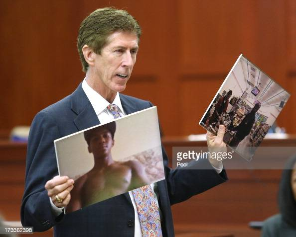 Mark O'Mara displays photos of Travyon Martin to the jury during closing arguments in Zimmerman's murder trial July 12 2013 in Sanford Florida Judge...