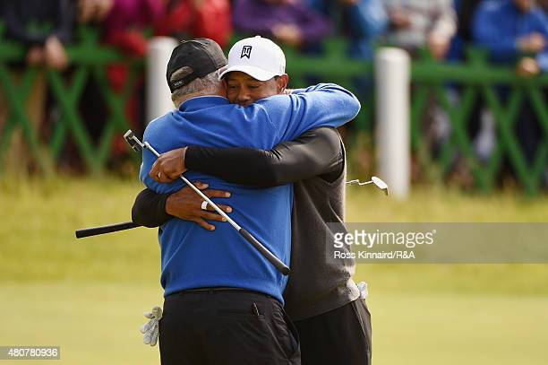 Mark O'Meara of the United States and Tiger Woods of the United States are seen on the 18th green during the Champion Golfers' Challenge ahead of the...