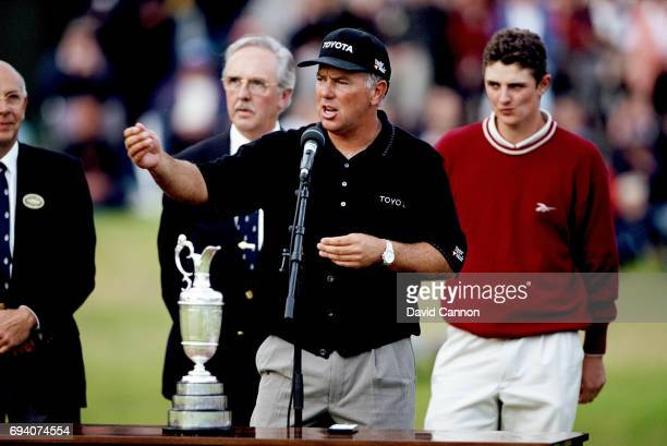 Mark O'Meara of the United States beside the Claret Jug after his win with Justin Rose of England behind who won the Silver Medal for the leading...