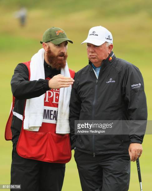 Mark O'Meara of the United States chats with his son and caddie Shaun O'Meara on the 3rd hole during the first round of the 146th Open Championship...