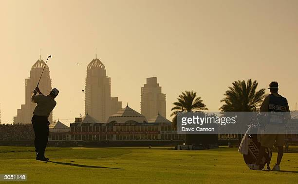 Mark O'Meara of the US plays his second shot at the 18th during the final round of the Dubai Desert Classic on the Majilis Course on March 7 2004 at...