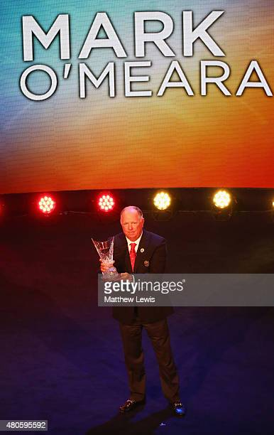 Mark O'Meara stands on stage as he is inducted into the World Golf Hall of Fame at St Andrews University on July 13 2015 in St Andrews Scotland