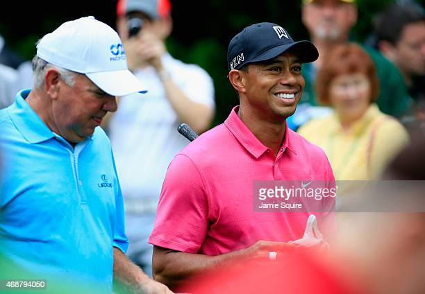 Mark O'Meara walks alongside Tiger Woods of the United States during a practice round prior to the start of the 2015 Masters Tournament at Augusta...