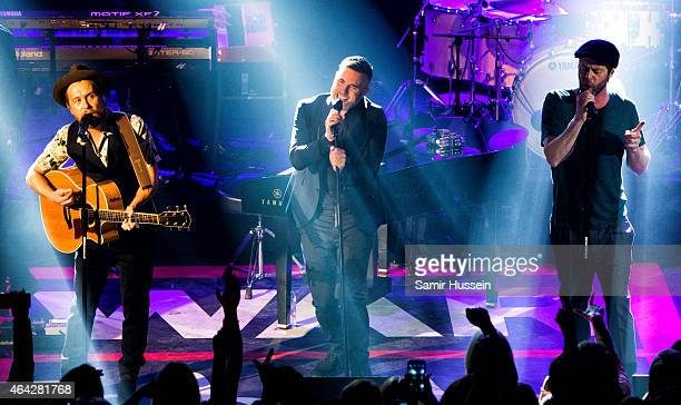 Mark Owen Gary Barlow and Howard Donald of Take That perform on stage for the War Child BRITs show at O2 Shepherd's Bush Empire on February 23 2015...