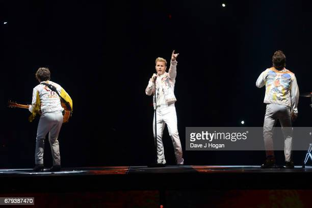 Mark Owen Gary Barlow and Howard Donald of Take That perform on the opening night of Wonderland Live 2017 at Genting Arena on May 5 2017 in...