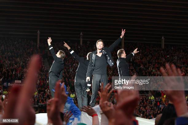 Mark Owen Jason Orange Gary Barlow and Howard Donald of Take That perform onstage during the first night show of 'Take That Present The Circus Tour...