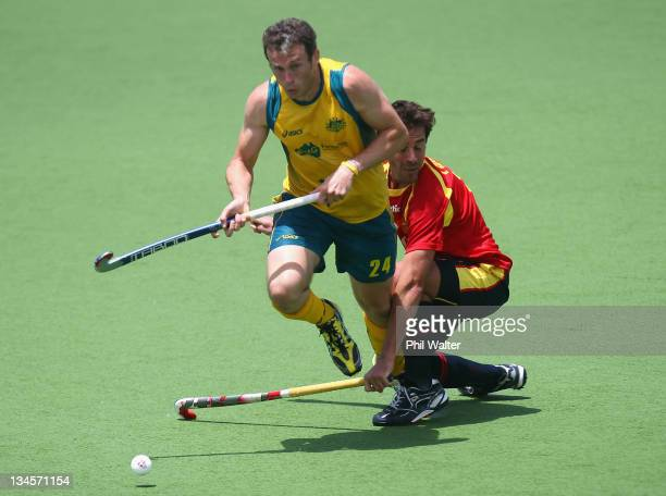Mark Paterson of Australia is tackled by Alex Fabregas of Spain during the match between Australia and Spain on day one of the 2011 Men's Champions...