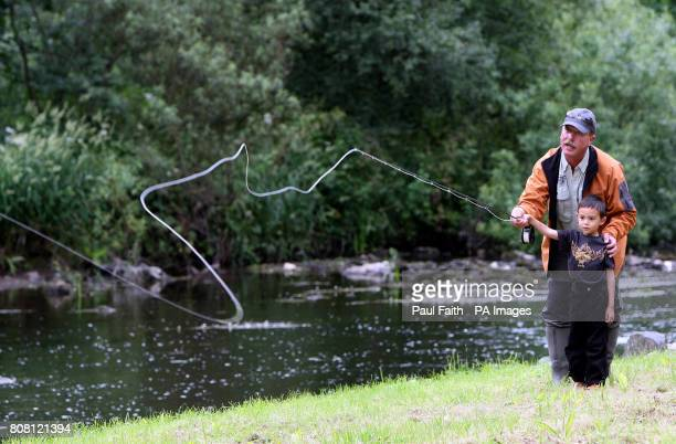 Mark Patterson instructs Kenneth Moffett how to use a fly rod at the River Bush Salmon Station Open Day in Bushmills Co Antrim The public were given...