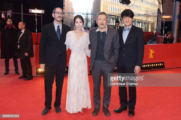 Mark Peranson actress Kim Minhee director Hong Sangsoo and Park HongYeol attend the 'On the Beach at Night Alone' premiere during the 67th Berlinale...
