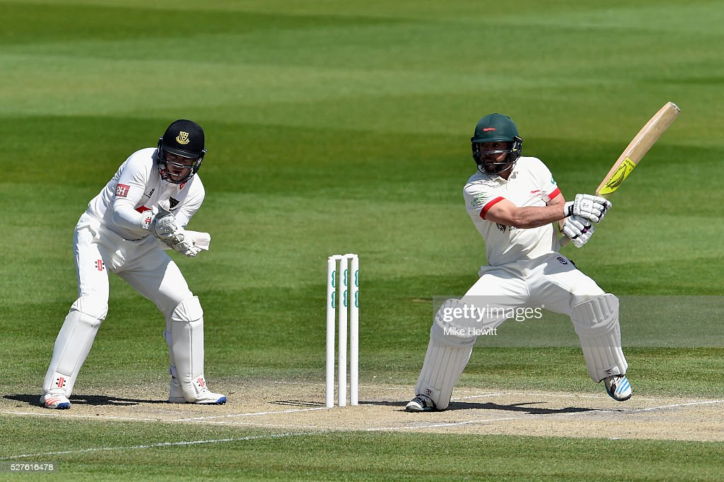 Mark Pettini of Leicestershire hits the two runs he needs to reach his century as wicketkeeper <a gi-track='captionPersonalityLinkClicked' href=/galleries/search?phrase=Ben+Brown+-+Kricketspelare&family=editorial&specificpeople=14828377 ng-click='$event.stopPropagation()'>Ben Brown</a> of Sussex looks on during the Specsavers County Championship Division Two match between Sussex and Leicestershire on May 03, 2016 in Hove, England.