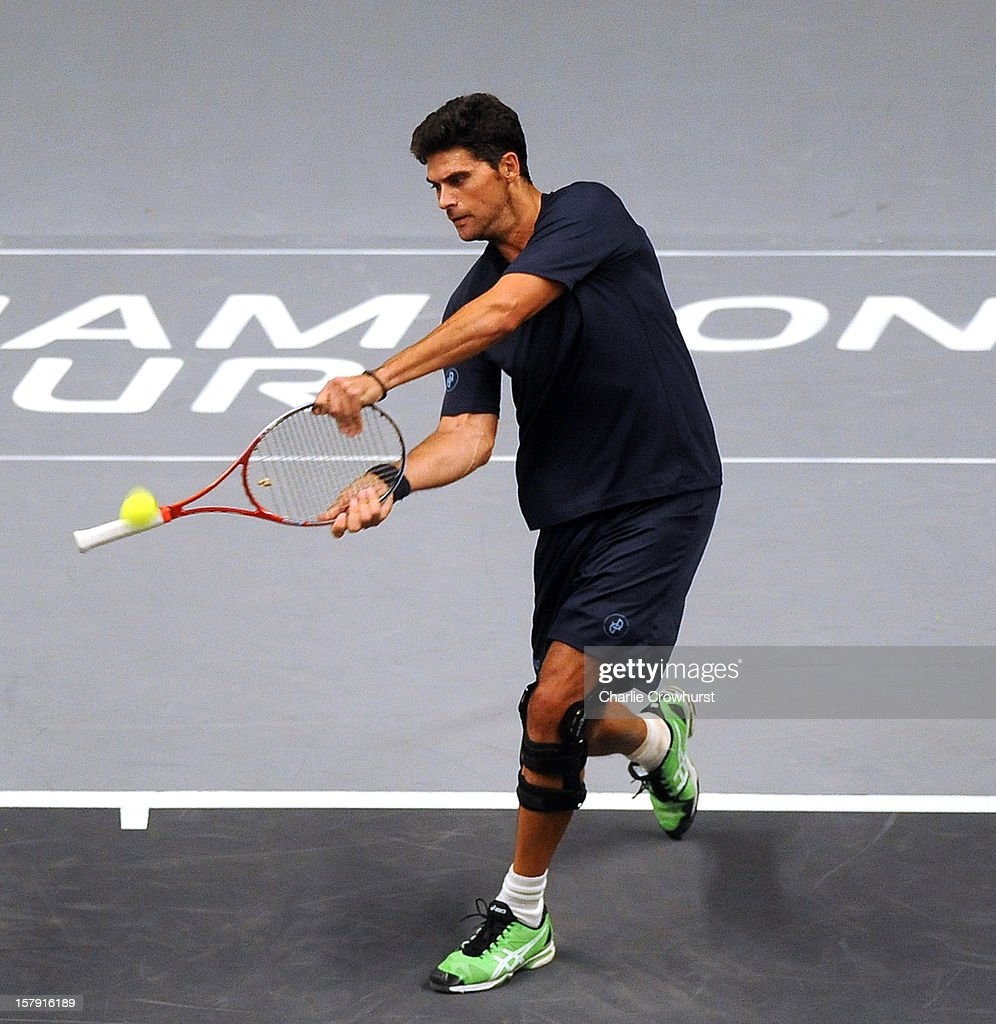 Mark Philippousis of Australia switches his racquet round and plays a golf swing during the match against Carlos Moya of Spain on Day Three of the Statoil Masters Tennis at the Royal Albert Hall on December 7, 2012 in London, England.