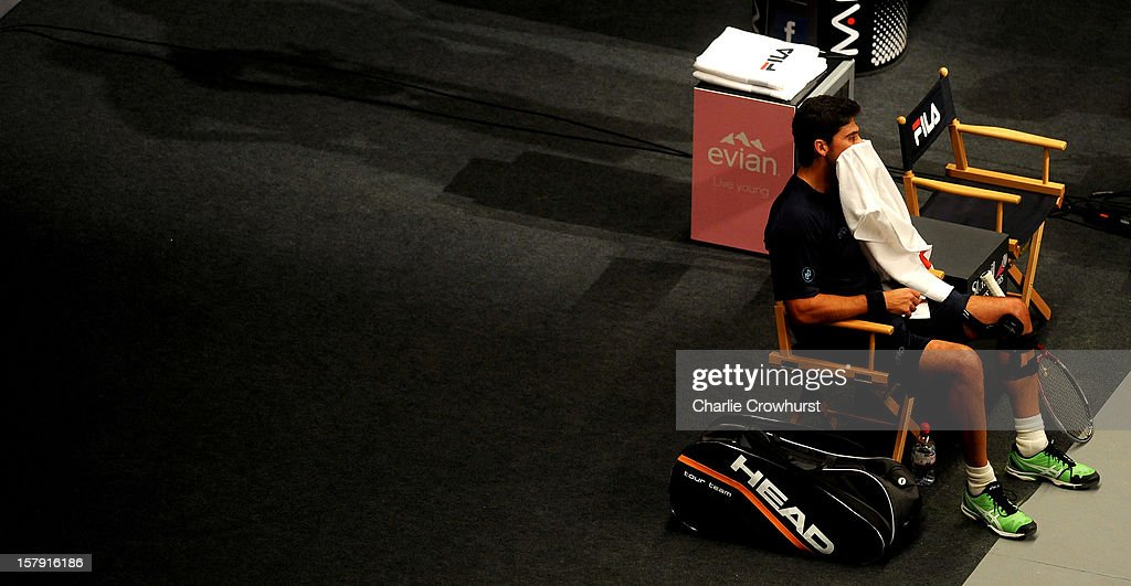 Mark Philippousis of Australia wipes his face with a towl during the match against Carlos Moya of Spain on Day Three of the Statoil Masters Tennis at the Royal Albert Hall on December 7, 2012 in London, England.