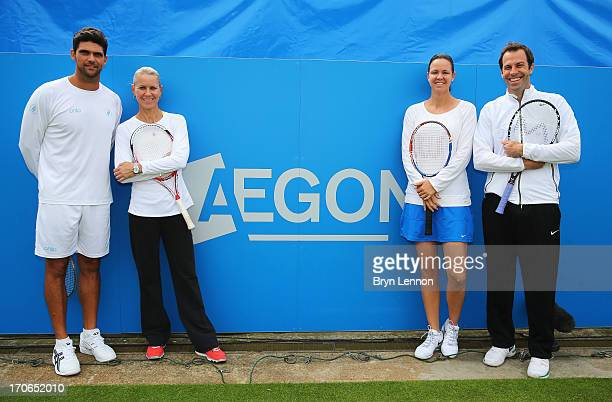 Mark Philippoussis and Rennae Stubbs of Australia pose with Lindsay Davenport of USA and Greg Rusedski of Great Britain on Legends' Day during day...