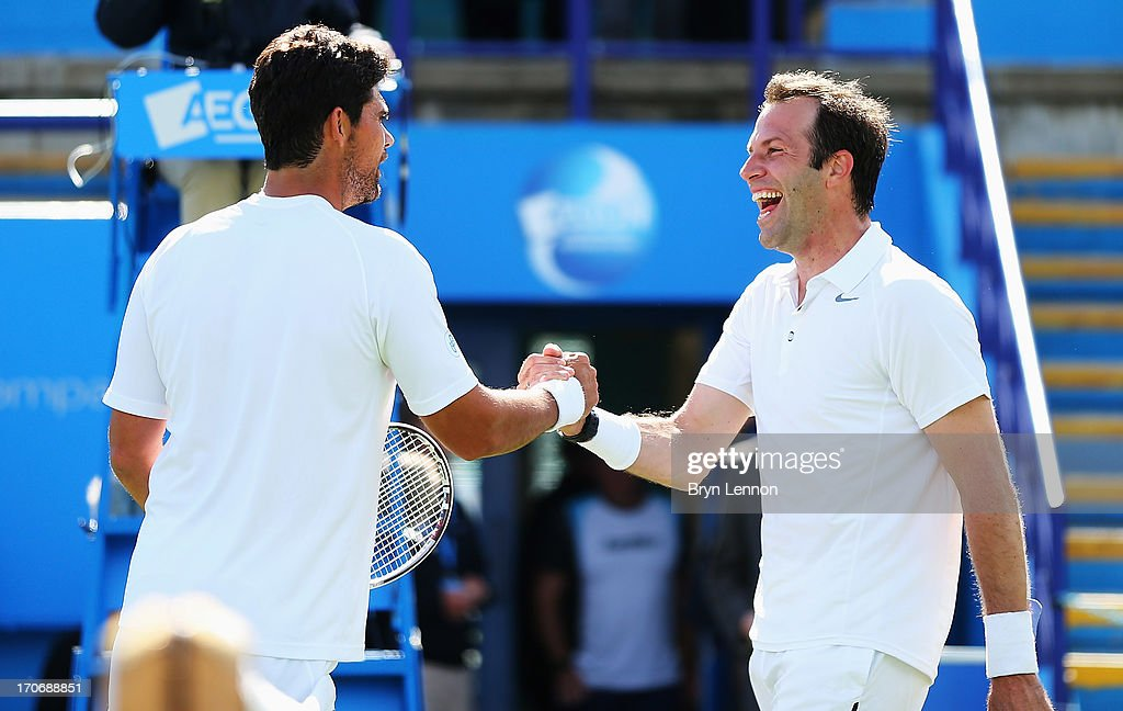 Mark Philippoussis (L) of Australia is congratulated by Greg Rusedski of Great Britain after their men's singles exhibition legends match during day two of the AEGON International tennis tournament at Devonshire Park on June 16, 2013 in Eastbourne, England.