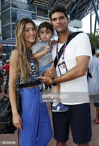 Mark Philippoussis of Australia poses with his wife Silvana Lovin Philippoussis and their son Nicholas Philippoussis in front of Arthur Ashe Stadium...