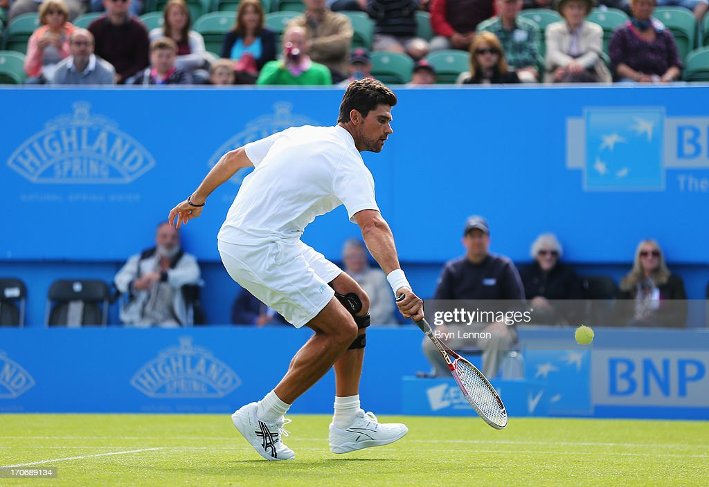Mark Philippoussis of Australia volleys in his men's singles exhibition legends match against Greg Rusedski of Great Britain during day two of the AEGON International tennis tournament at Devonshire Park on June 16, 2013 in Eastbourne, England.
